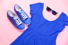 Gumshoes, sunglasses and dress Stock Images