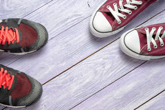 Gumshoes. Two pair of gumshoes on a wooden background with copy space Royalty Free Stock Images
