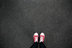 Gumshoes on urban grunge background of asphalt. Conceptual image Stock Image