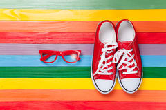 Gumshoes with white shoelaces and glasses Stock Photography