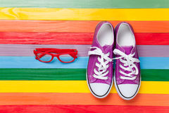 Gumshoes with white shoelaces and glasses stock photo