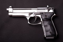 GUN. Automatic gun on on the dark background Stock Photos