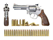 Gun. Several objects in different positions of the gun and bullets. All objects are over white Royalty Free Stock Image
