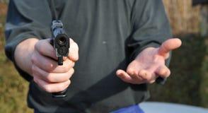 Gun. A man threatening with a gun Stock Photo