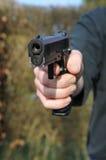 Gun. A man threatening with a gun Stock Photography