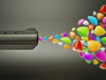 Gun. Colored fraction ejected from the gun Royalty Free Stock Images