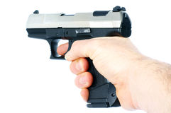 Gun. Hand with a Gun over a white Background Royalty Free Stock Photography