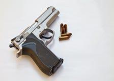 Gun. Semi-automatic pistol and bullets Stock Photography