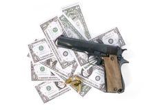 Gun. Semi-automatic gun, bullets and banknotes royalty free stock photos