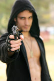 Gun. A gun holded by a young man Stock Image