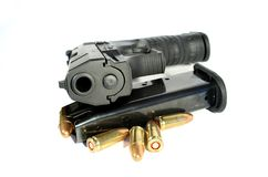 Gun. Real gun and clip with ammo 9 mm Royalty Free Stock Images