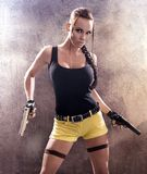 Gun. Young athletic woman with gun Stock Photo