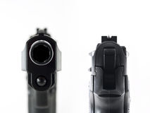 Gun aiming and staring into the barrel. Close up shot of a pistols front and back. Staring into the barrel and aiming Royalty Free Stock Images