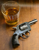 Gun and alcohol Stock Photo