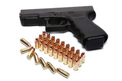 Gun and ammunition Royalty Free Stock Photography