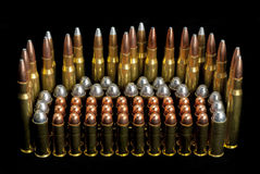 Gun ammunition bullets different sizes Stock Photography