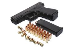 Gun and ammunition Stock Images