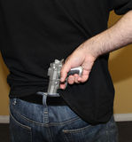 Gun in back of pants Royalty Free Stock Photos