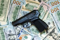 Gun on the background of banknotes Royalty Free Stock Images