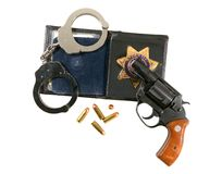 Gun, Badge and Handcuffs Royalty Free Stock Image