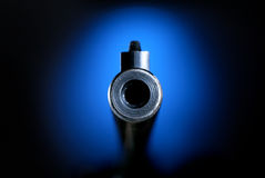 Gun barrel. On blue pointing straight on Stock Images