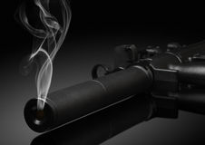 Gun barrel with smoke Royalty Free Stock Photos