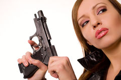Gun and beauty. Sexy young woman with a gun isolated on white Stock Images
