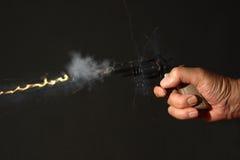 Gun being fired Stock Image