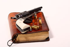 gun and the Bible Royalty Free Stock Image