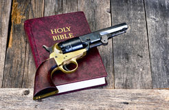 Gun and Bible. royalty free stock photo
