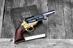 Gun and Bible. royalty free stock photos