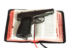 Gun on Bibles Royalty Free Stock Images