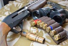 Gun and binoculars and duck call Royalty Free Stock Photo