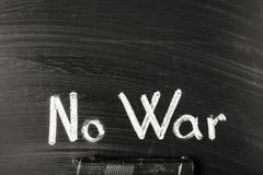 No war. The gun on the board near to the inscription no war stock photography