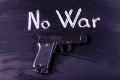 No war. The gun on the board near to the inscription no war, toned image stock images