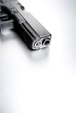 Gun on brushed metal background Royalty Free Stock Photos