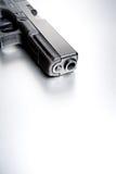 Gun on brushed metal background Royalty Free Stock Photos