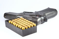Gun and bullet. In white background Royalty Free Stock Photography