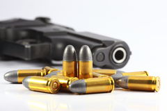 Gun and bullet. In white background Stock Images