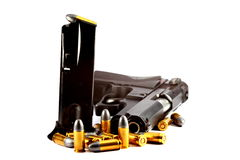 Gun and bullet. In white background Royalty Free Stock Photos
