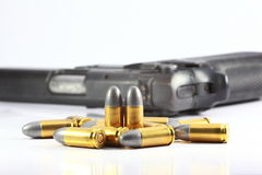Gun and bullet. In white background Stock Photo