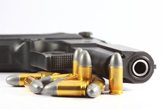 Gun and bullet. In white background Stock Photos