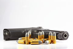 Gun and bullet. In white background Stock Photography