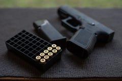 Gun and bullet. On black stock image
