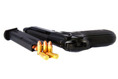 Gun and bullet Royalty Free Stock Photography