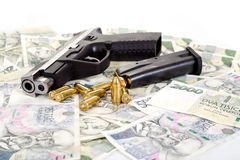 Gun with bullet on czech banknotes Royalty Free Stock Images