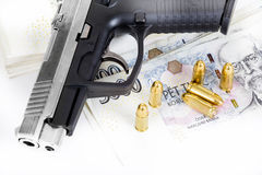 Gun with bullet on czech banknotes Stock Photos