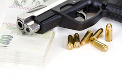 Gun with bullet and czech banknotes Stock Photography