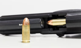 Gun and Bullet. A gun 98FS Beretta open with a bullet inside and a bullet out in front of it Royalty Free Stock Photo