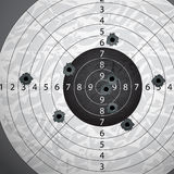 Gun bullet`s holes. On paper target Royalty Free Stock Photo